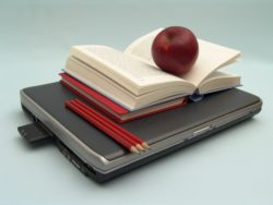 RODNEY HARMON SCHOLARSHIP fund picture of laptop with books on top
